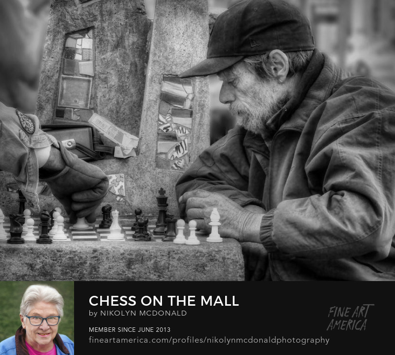 friends playing chess on city street photo by Nikolyn McDonald