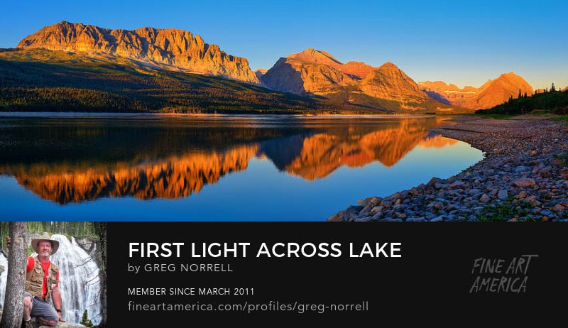 First Light on the mountains behind Lake Sherburne in Glacier National Park