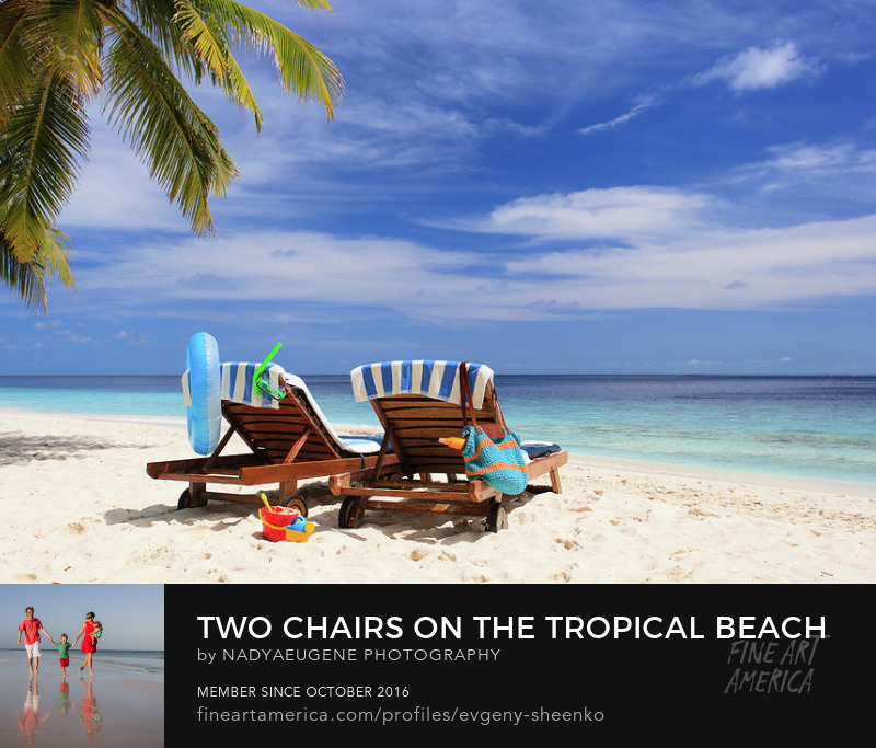 Two chairs on a tropical beach by Nadya&Eugene Photography