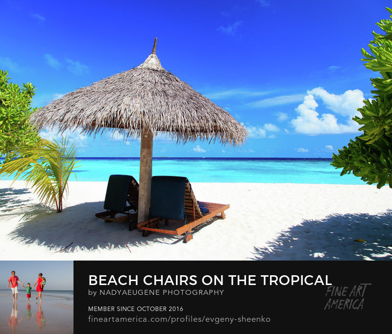 Beach chairs on a tropical beach by Nadya&Eugene Photography