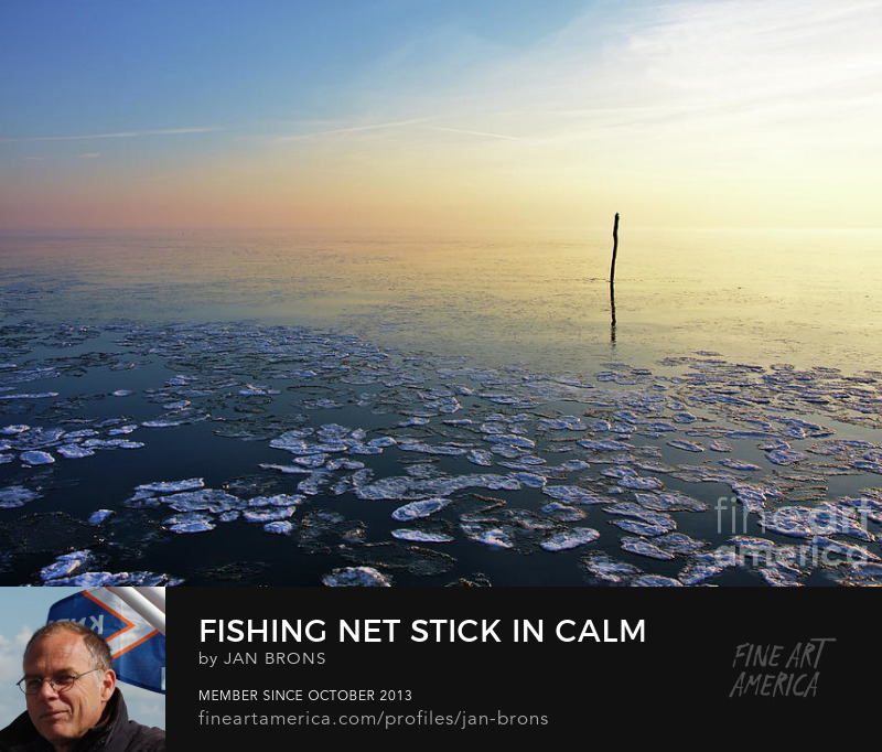 Fishing Net Stick In Calm Frozen Water - Art Online