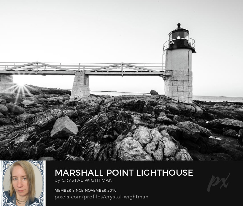 A black and white landscape of Marshall Point Lighthouse in Maine at sunrise.
