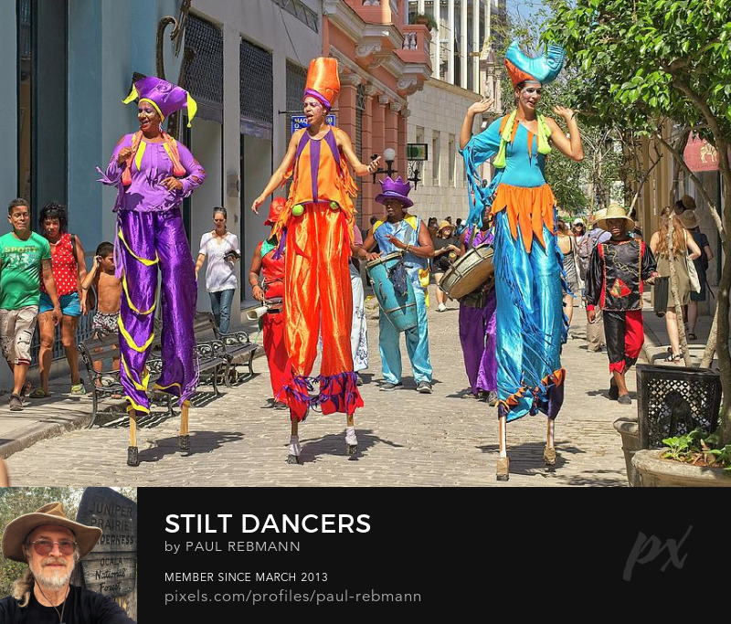 View online purchase options for Stilt Dancers by Paul Rebmann