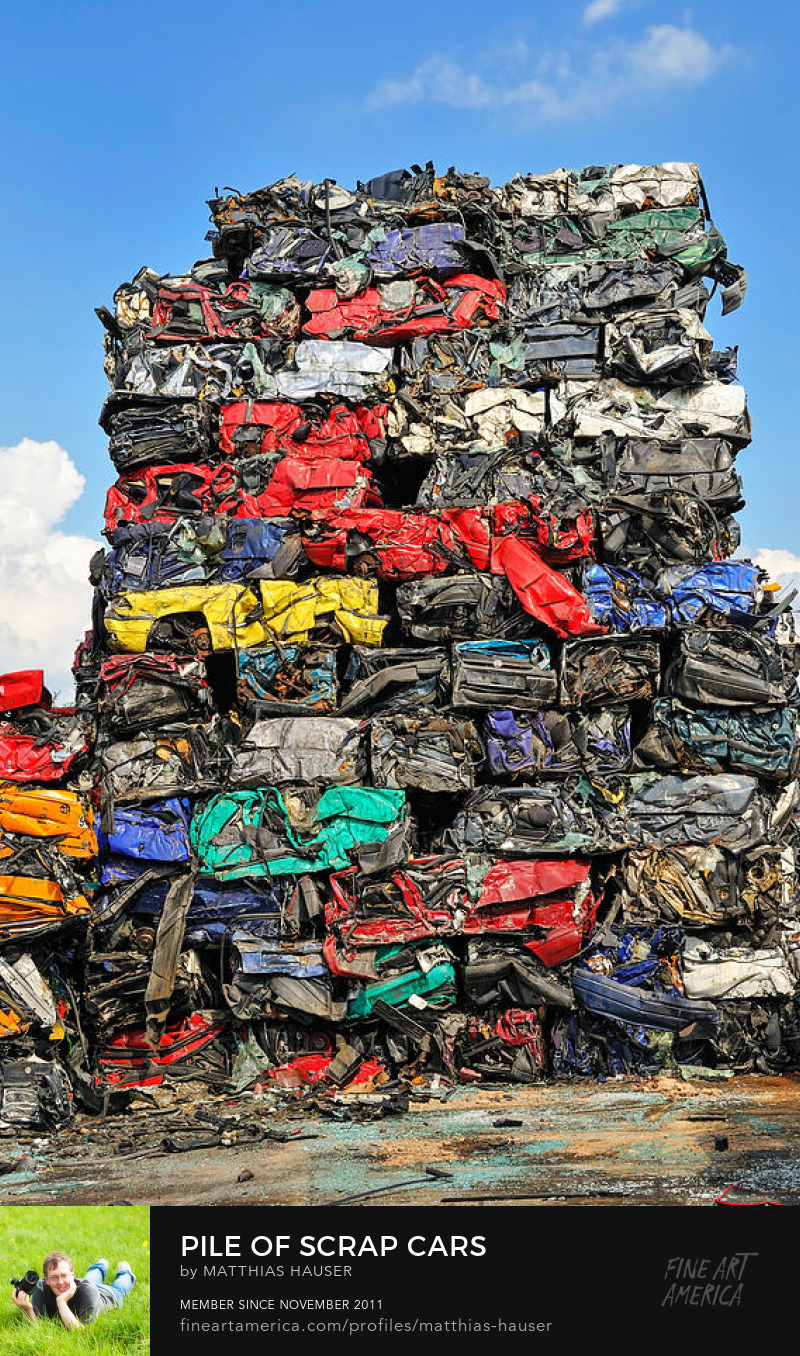 Colorful pile of scrap cars on wrecking yard by Matthias Hauser