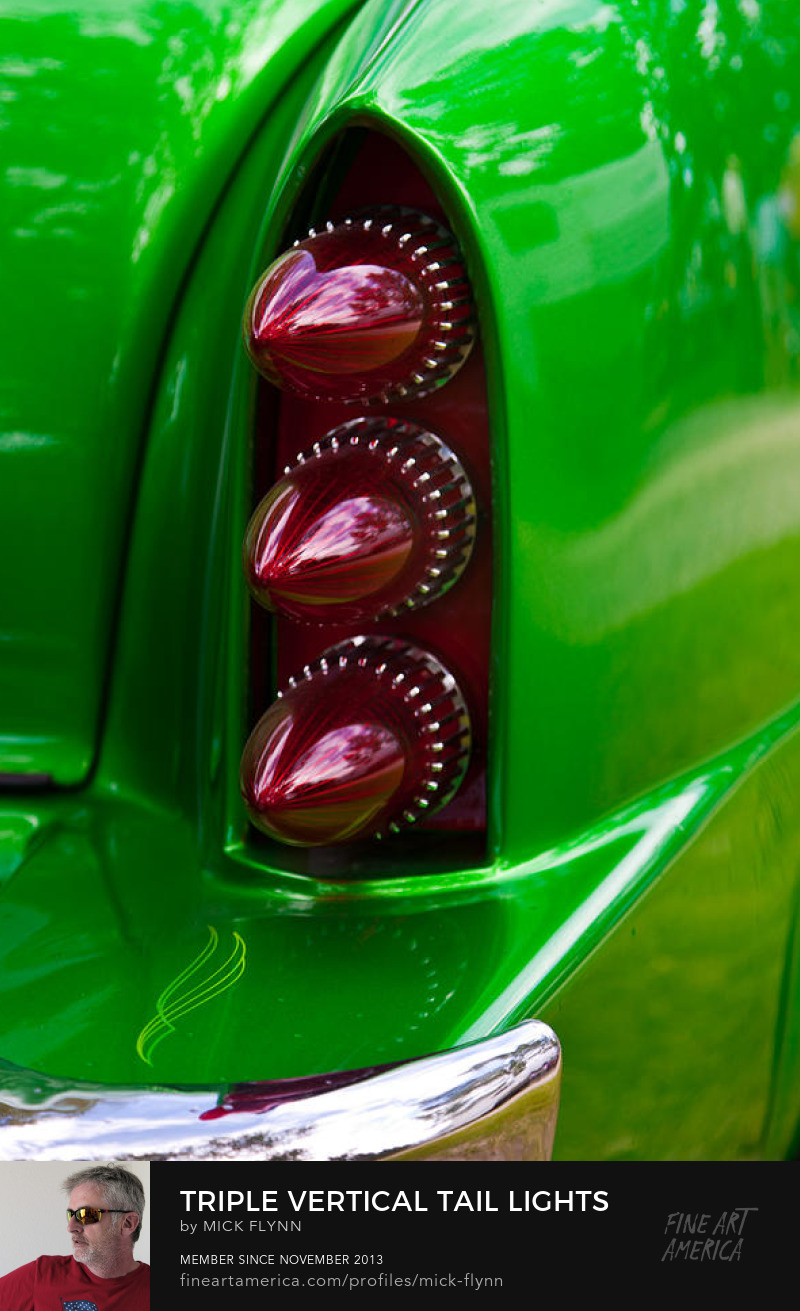 Triple vertical tail lights on green custom car