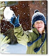 A Boy Throws A Snowball While Playing Acrylic Print