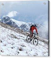 A Mountain Biker Rides Through The Snow Acrylic Print