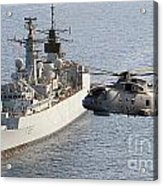 A Royal Navy Merlin Helicopter Passes Over Hms Cumberland Acrylic Print
