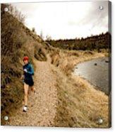 A Woman Jogging On A Dirt Trail Acrylic Print