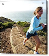 A Woman Running Stairs Near The Ocean Acrylic Print