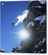 An Extreme Skier Jumps Off A Snowy Acrylic Print