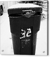 bag sticking out of litter waste bin covered in snow outside house in Saskatoon Saskatchewan Canada Acrylic Print by Joe Fox