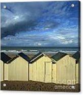 Beach Huts Under A Stormy Sky In Normandy. France. Europe Acrylic Print by Bernard Jaubert