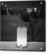candle in the window looking out over snow covered scene in small rural village of Forget Saskatchew Acrylic Print