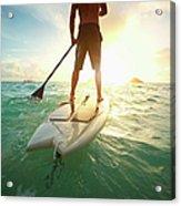 Caucasian Man On Paddle Board In Ocean Acrylic Print