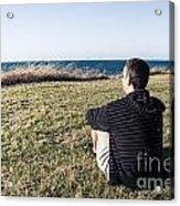 Caucasian Traveler Relaxing On Grass Outdoors Acrylic Print