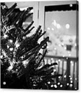decorated christmas tree looking out of window to snow covered scene in small rural village of Forge Acrylic Print