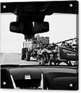 driving behind combine harvester on road in Saskatchewan Canada Acrylic Print