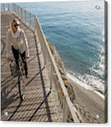 Elevated Perspective Of Woman Riding Acrylic Print