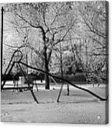 empty childrens playground with hoar frost covered trees on street in small rural village of Forget  Acrylic Print