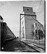 grain elevator and old train track with grain railcars leader Saskatchewan Canada Acrylic Print
