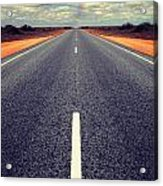 Long Straight Road With Gathering Storm Clouds Acrylic Print by Colin and Linda McKie