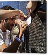 Man Getting A Rubbing Of Fallen Soldier's Name At The Vietnam War Memorial Acrylic Print
