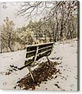 Park Bench In The Snow Covered Park Overlooking Lake Acrylic Print