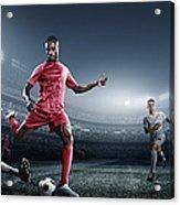 Soccer Player Kicking Ball In Stadium Acrylic Print