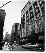 yellow cabs wait outside Macys at Broadway and 34th Street Herald Square new york Acrylic Print