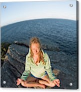 Yoga On Rocky Outcrop Above Ocean Acrylic Print
