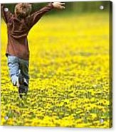 Young Boy Running Through Field Of Acrylic Print