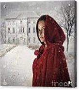 Young Woman Wearing Hooded Cape In Snowy Winter Scene Acrylic Print