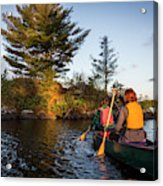A Young Couple Paddles A Canoe On Long Acrylic Print