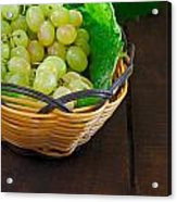 Basket Of Grapes On Rustic Wooden Table Acrylic Print