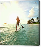Caucasian Man On Paddle Board In Ocean Acrylic Print