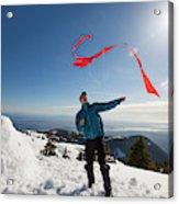 Flying A Kite On A Snowy Mountain Acrylic Print