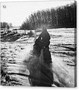 man on snowmobile crossing frozen fields in rural Forget Saskatchewan Canada Acrylic Print by Joe Fox