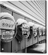 snow covered electricity meters in Saskatoon Saskatchewan Canada Acrylic Print