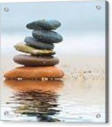 Stack Of Beach Stones On Sand Acrylic Print