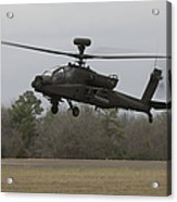 An Ah-64 Apache Helicopter In Midair Acrylic Print