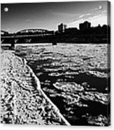 large chunks of floating ice on the south saskatchewan river in winter flowing through downtown Sask Acrylic Print