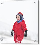 A Two Year Old Boy Plays In A Snowy Acrylic Print