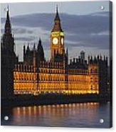 A Building And Clock Tower Along The Acrylic Print by Charles Bowman