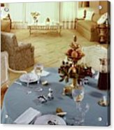 A Dining Room With A Blue Tablecloth And Ornate Acrylic Print