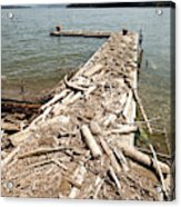 A Dock Covered With Driftwood Acrylic Print