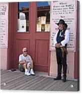 A Dog And A Re-enactor Rest In The Front Of The Bird Cage Theater Tombstone Arizona Acrylic Print