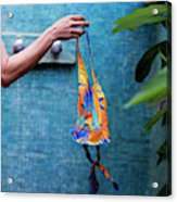 A Female Hand Holding A Bathing Suit Acrylic Print