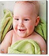 A Happy Baby Lying On Bed In Green Towel Acrylic Print