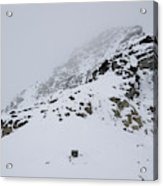 A Hiker Approaches A Snowy Peak Covered Acrylic Print
